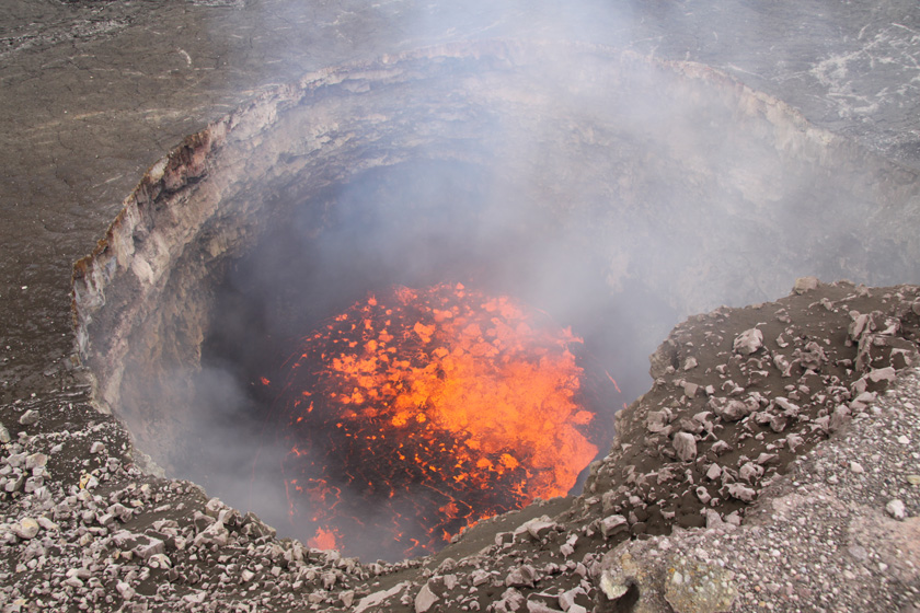 Volcano summit churns and pops as rocks fall into the lava lake