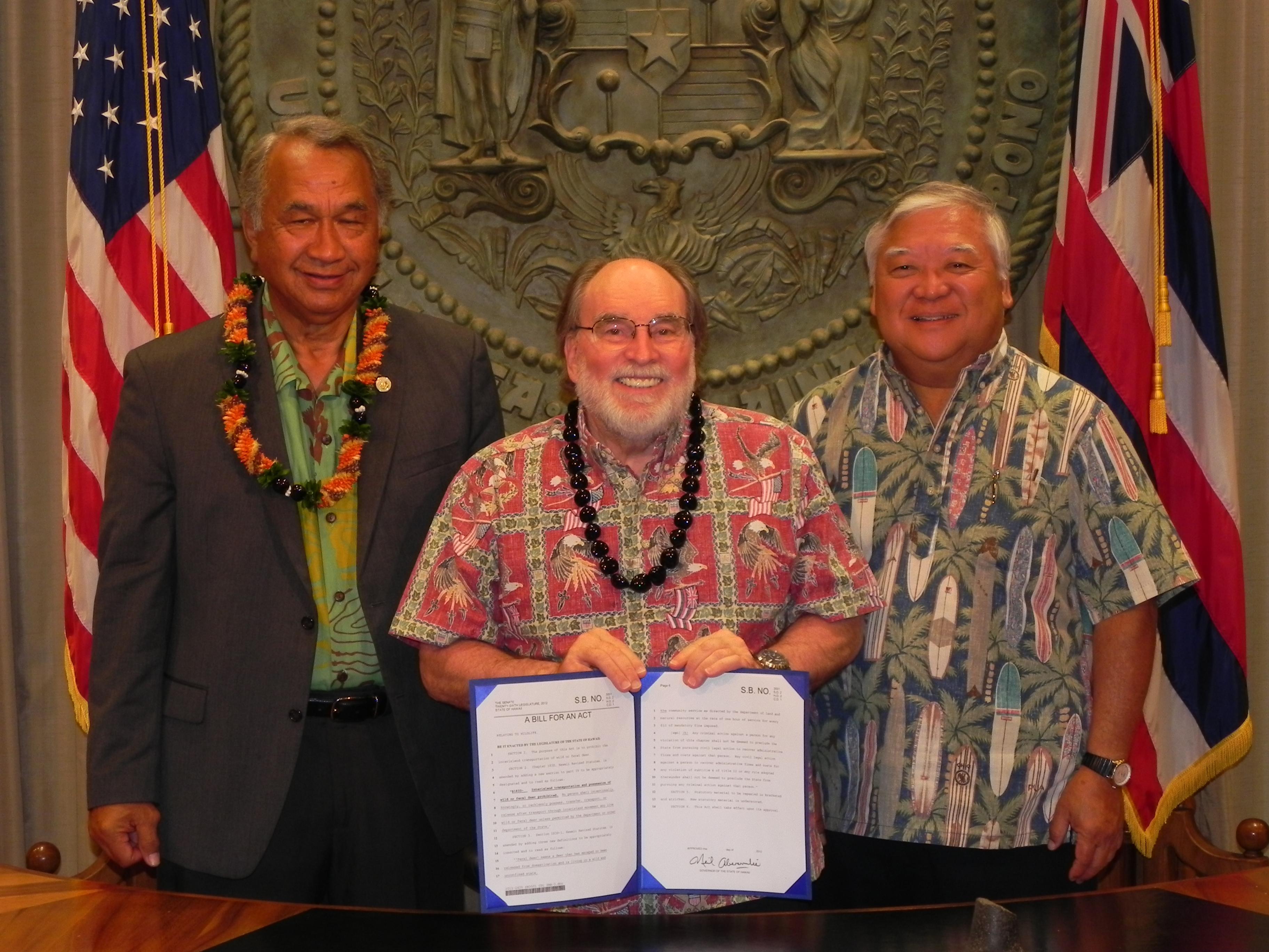 Senator Gilbert Kahele and Senator Clarence Nishihara join Governor Abercrombie for the signing of Senate Bill 3001 into law. Photo Courtesy:  Senate Communications