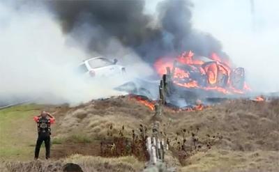 VIDEO: Fire burns Saddle Road after vehicle crash