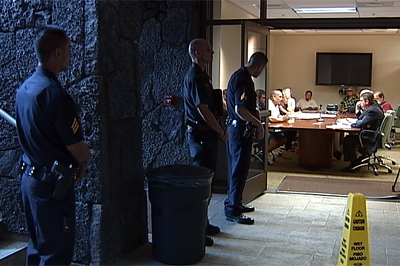 Police stand outside accreditation hearing in Hilo