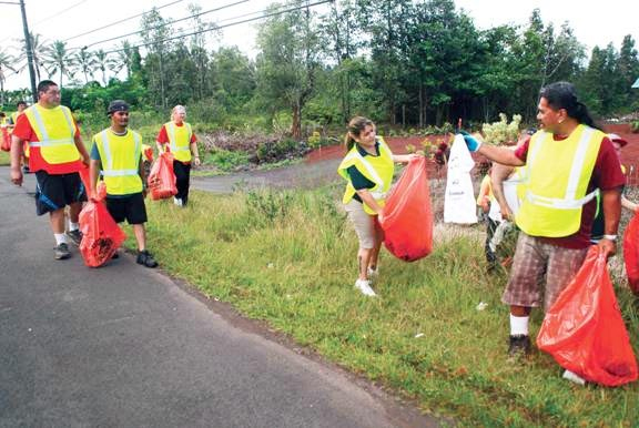 """Volunteers pick up trash along Highway 130 in Puna during a coordinated """"Adopt a Highway"""" project on August 25, photo courtesy Hawaii County Police"""