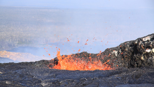 USGS HVO photo: The lava pond at the northeast cone had several spatter sources active on the pond margin, throwing spatter to a height of a few meters (yards).
