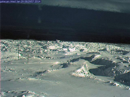 Snow covers the lava on Mauna Loa near the access gate to the observatory.