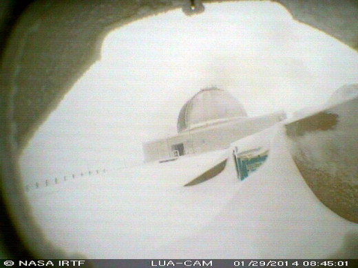 One of the few clear views of the snow brought to you by the NASA Infrared Telescope Facility. Taken at 8:45 a.m. HST