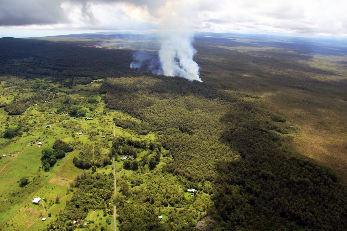 Wide shot of the flow front taken by USGS HVO, showing the lava moving through the forested northwest portion of the Kaohe subdivision. The flow front was 3.3 km (2.1 miles) upslope from Apaʻa Road and 4.3 km (2.7 miles) from Pāhoa Village Road.
