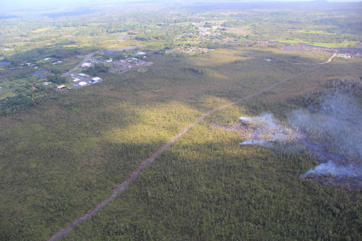 This USGS photo shows the flow was very close to a firebreak road cut several months ago. The Pahoa Transfer Station is at upper right. The view is to the southeast.