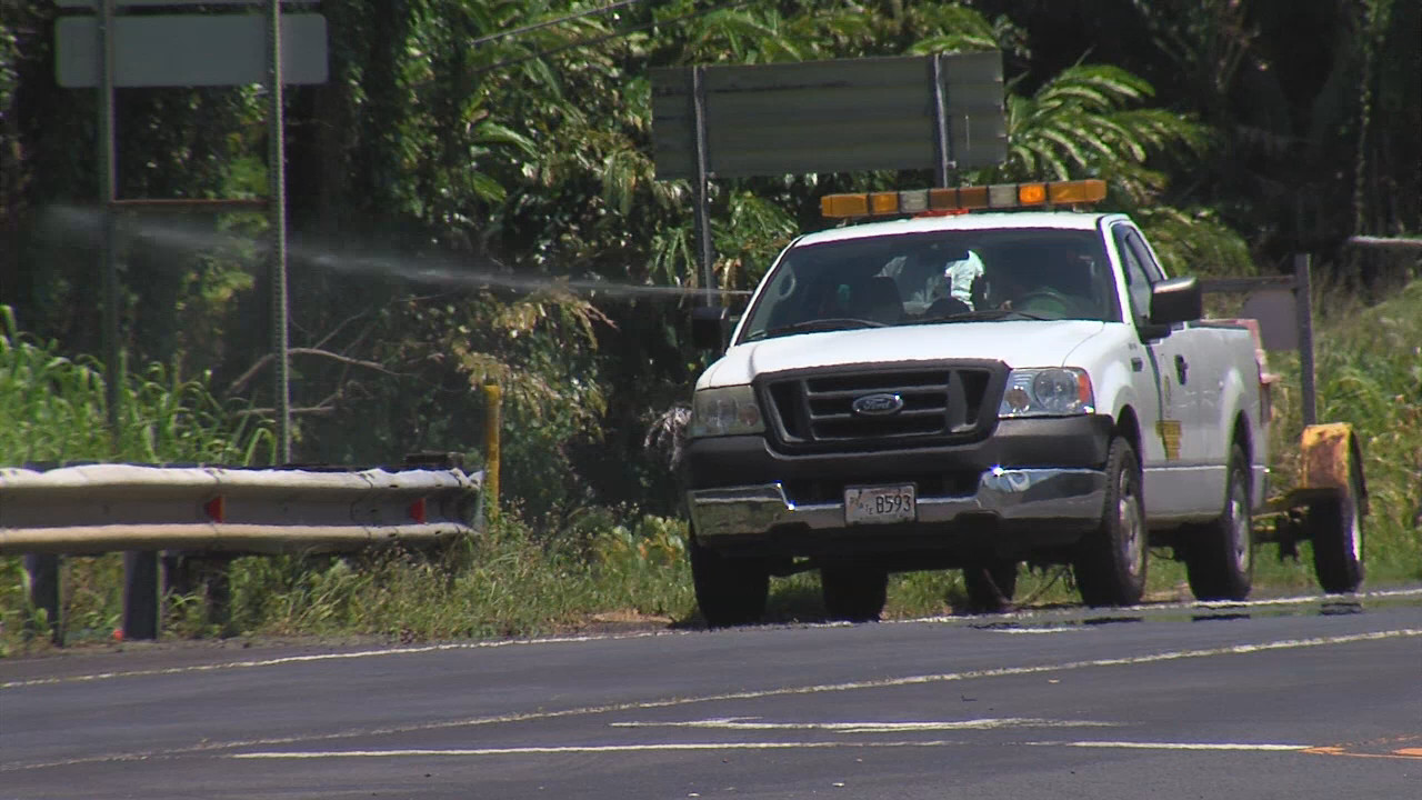 County truck filmed as it apparently sprays Roundup into the weeds along Highway 19 near Paukaa.