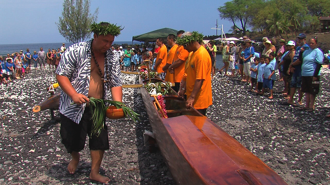 Mahina Kaupiko blesses the Nai'a on the shore of Miloli'i on April 23, 2016.