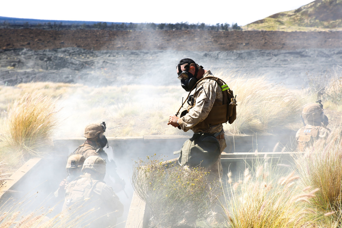 A Marine with Kilo Company, 3rd Battalion, 3rd Marine Regiment, observes as Marines are gassed in trenches during training exercise Lava Viper, a staple of their pre-deployment training, at Range 10 aboard Pohakuloa Training Area, Hawaii, Nov. 4, 2015. (U.S. Marine Corps photo by Lance Cpl. Harley Thomas)