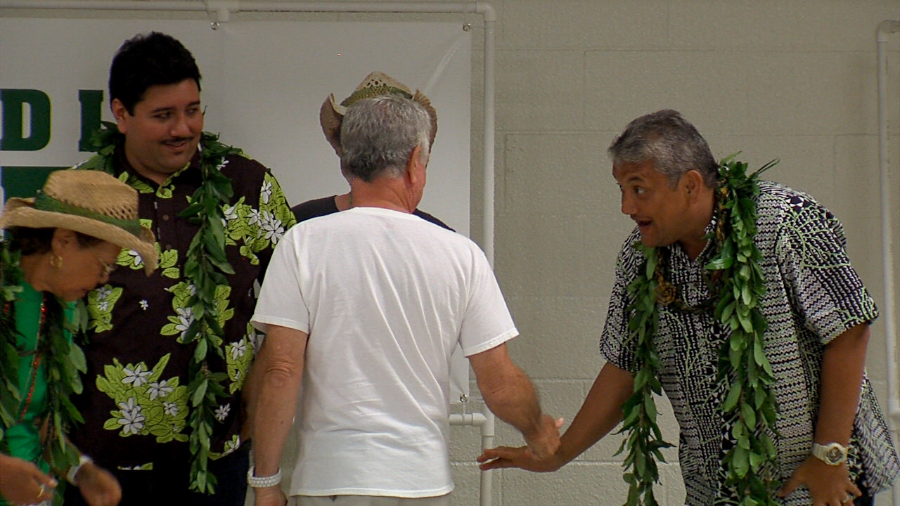 Kenoi greets fellow Democrats following his short speech on Monday evening.