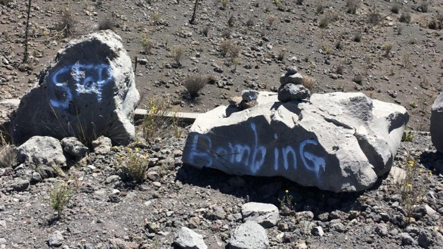 Graffiti Found On Mauna Kea Rocks, Portable Toilets