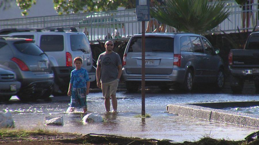 VIDEO: High Tides Flood Moku Ola Parking Lot