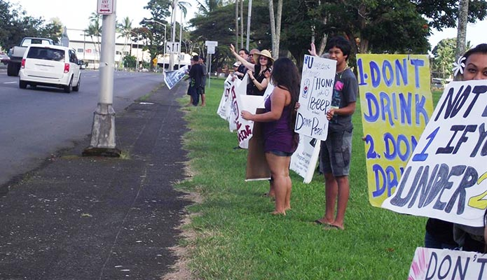 Hilo sign waving reminds Super Bowl fans of DUI dangers