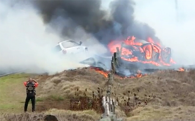 VIDEO: Fire burns Saddle Road after vehicle crash