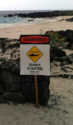 A sign posted warning of sharks after an attack closed Kekaha Kai State Park in Kona (courtesy DLNR)
