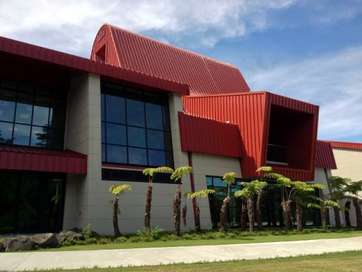 Hapu fern surround the distinct Hale'olelo building