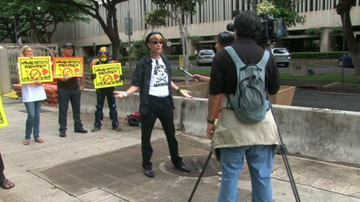 "Brad ""Tiki Shark"" Parker does an interview with media outside the U.S. District Court on Oahu."