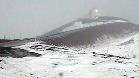 Snow covers Mauna Kea summit, road closed