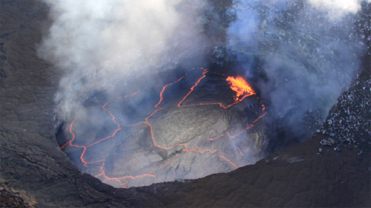 Mar 7, 2014: The lava lake in the Overlook crater, within Halemaʻumaʻu Crater, at Kīlauea's summit remains active. Today, winds carried the plume towards the north, providing a clear view of the persistent spattering area in the southeast portion of the lake. (USGS HVO photo)