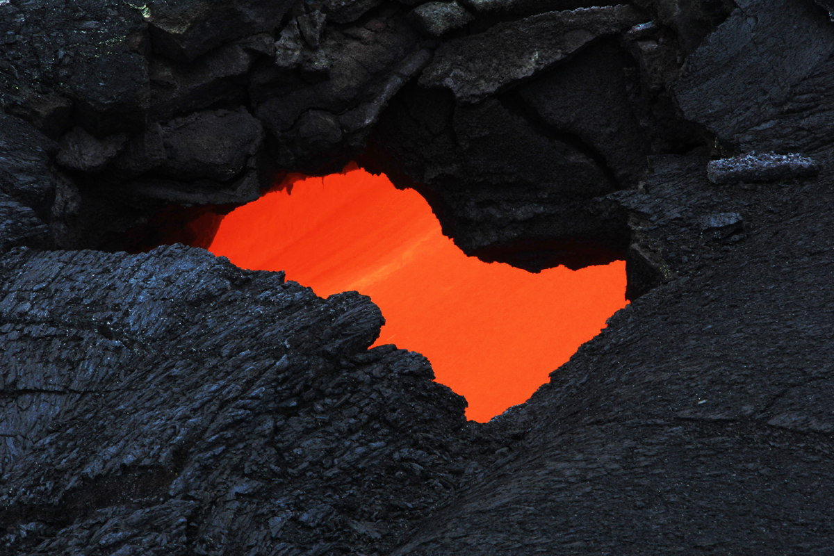 USGS HVO photo shows a skylight which provided a view of the swiftly moving lava stream in the lava tube.