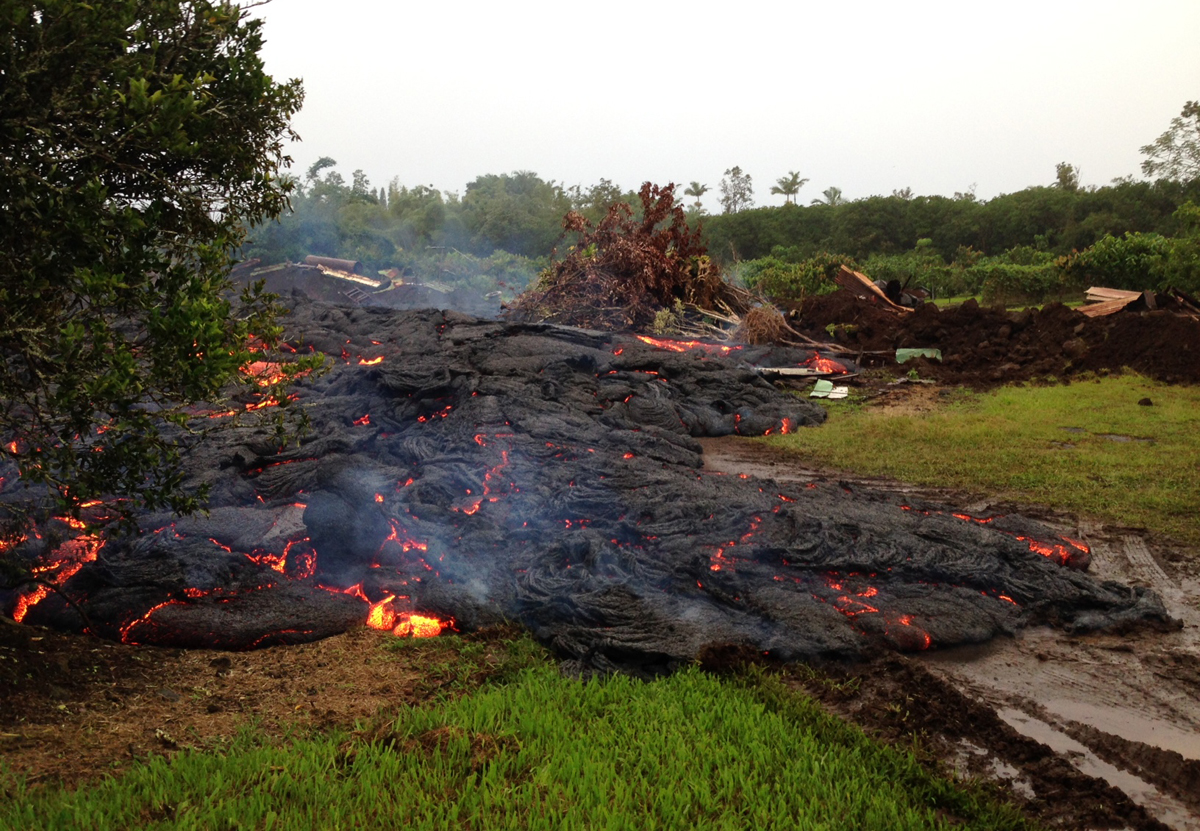 This USGS Hawaiian Volcano Observatory photo from 6:30 a.m., HST, on Wednesday, October 29, 2014, shows lava from the June 27th flow continuing to move downslope through the property it entered the previous morning.