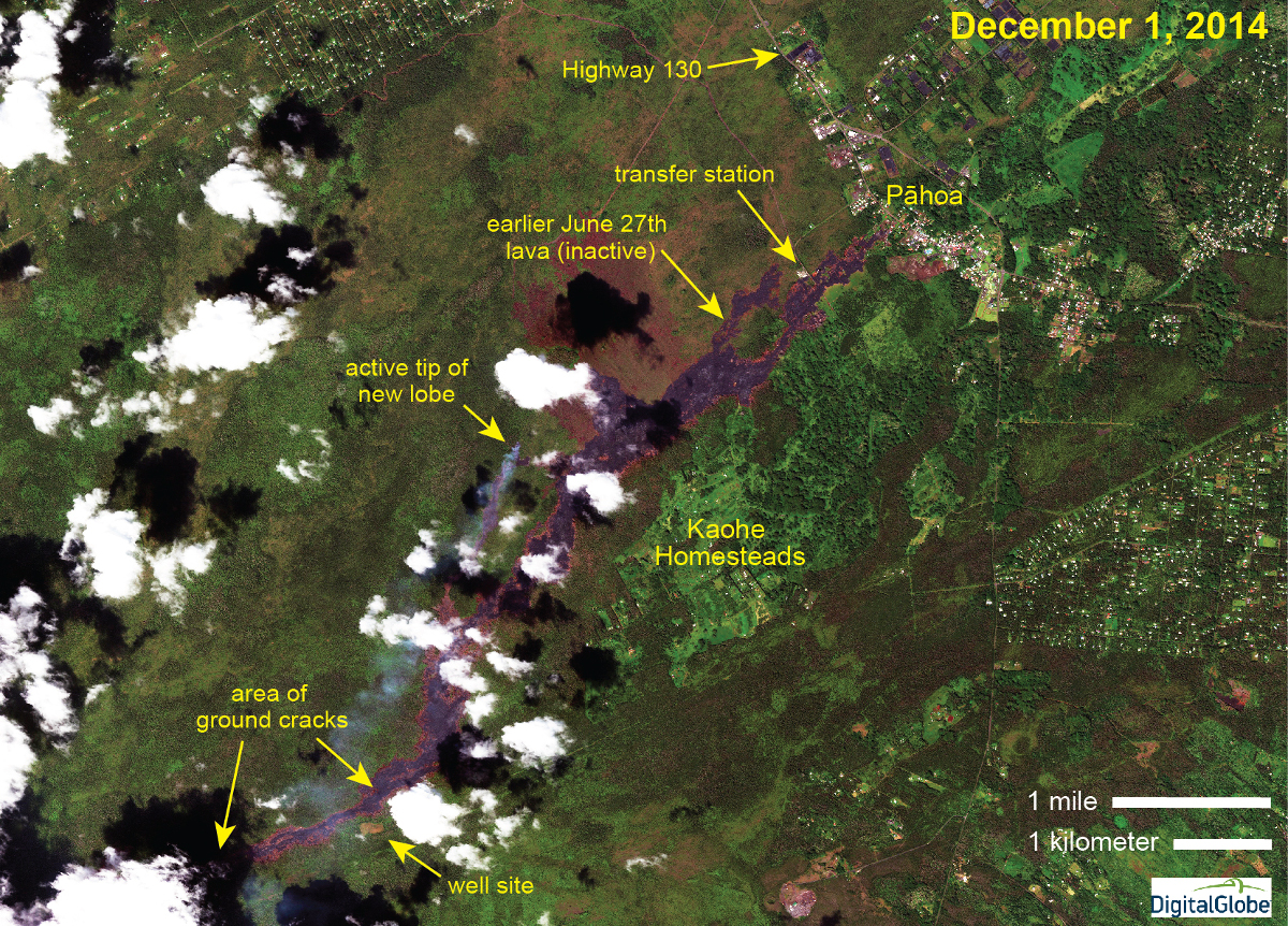This USGS Hawaiian Volcano Observatory image was acquired yesterday (December 1, 2014) by the WorldView 2 satellite, and shows the activity in the downslope portion of the June 27th lava flow. The portion of the June 27th lava flow that entered Pāhoa in October is inactive, but a new lobe is advancing downslope a short distance west of the earlier flow. The leading tip of the new lobe is evident by its long smoke plume, caused by vegetation burning. A Civil Defense overflight this morning (December 2, 2014) showed that this active tip continues to move towards the northeast.
