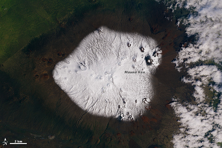 The Operational Land Imager (OLI) on Landsat 8 captured a view of the snow-capped summit on March 10, 2015. Courtesy NASA.