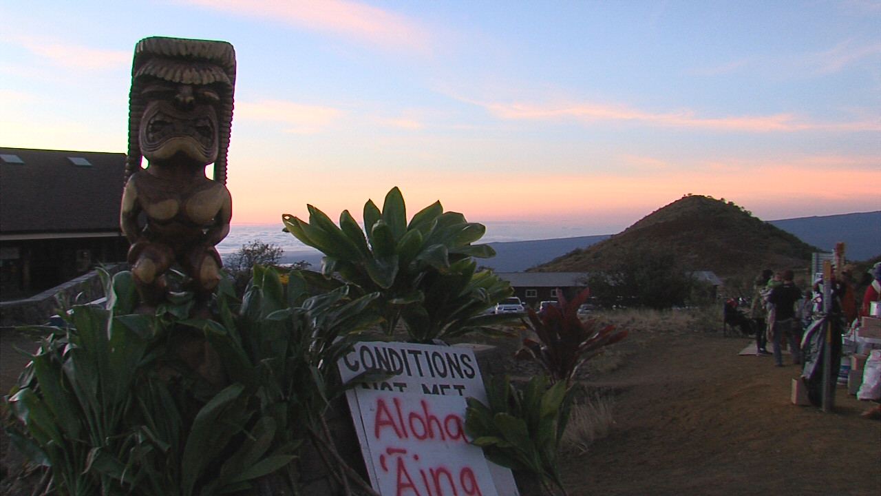 Kū, present on the day of the arrests and since, seen in the foreground as the sun rises over Hawaii Island on Thursday morning.