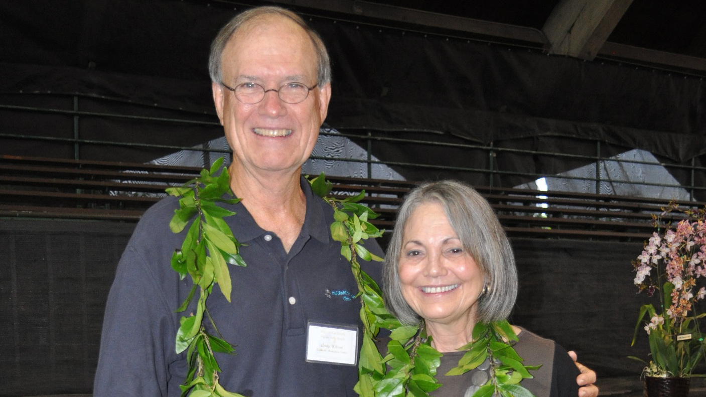 Andy Wilson & Sandy Song in 2012. The Hilo Orchid Show Preview Party on Thursday, August 6 is dedicated to the late Sandra Song (right) as a tribute to her years of devoted board service to Ku'ikahi Mediation Center, and her avid orchid growing and judging.  The late Song and Judge Andrew Wilson (left) were founding board members of Ku'ikahi.