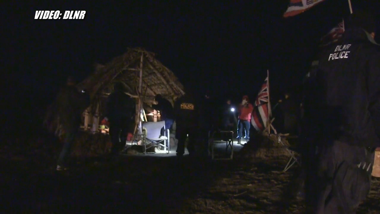 Arrestees were apparently huddled together in Hale Kukiaimauna when they were taken by DLNR officers. Image from DLNR video.