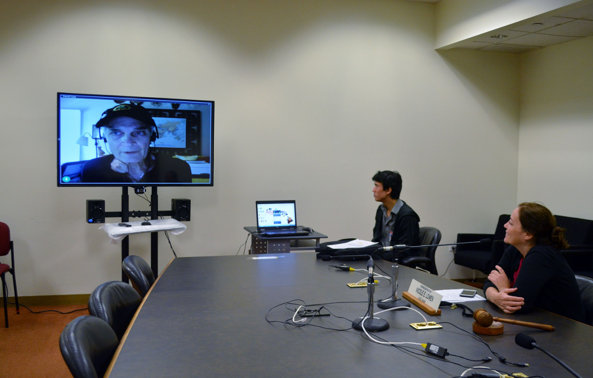 Rep. Lowen looks on during a demonstration of the remote testimony pilot project at the State Capitol. On March 1, the House committee was able to successfully communicate with Kailua-Kona resident David Case. (State House photo)