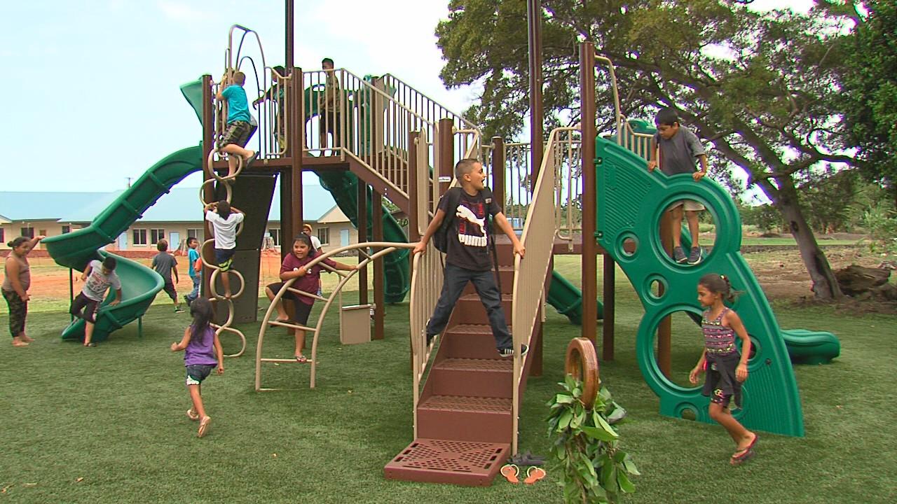 Kids play on the new Pahala playground