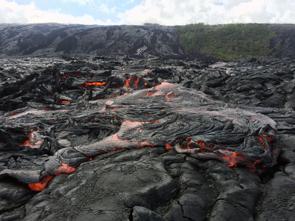 (USGS photo) On July 2, the flow front was roughly a quarter mile out from the base of the pali, and was 1.8 miles from the ocean. Scientists say the front consisted of slabby pāhoehoe, though ʻaʻā was also active at the base of the pali.