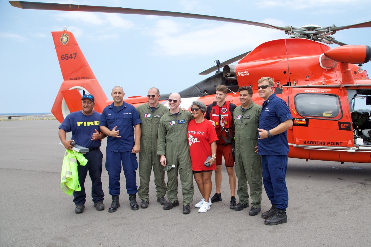 Coast Guard and Hawaii Fire Department personnel stand with the mother of Sidney Uemoto following her daughter's rescue. (U.S. Coast Guard photo/Released)