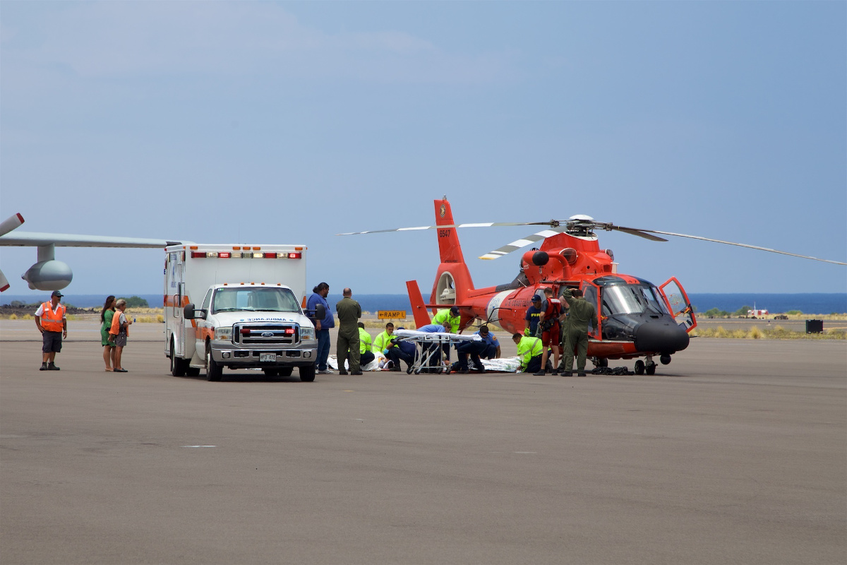 Coast Guard crews safely deliver David McMahon and Sidney Uemoto to emergency medical personnel in Kona, Hawaii, July 15, 2016. (U.S. Coast Guard photo by Lt. Cmdr. Kevin Cooper/Released)