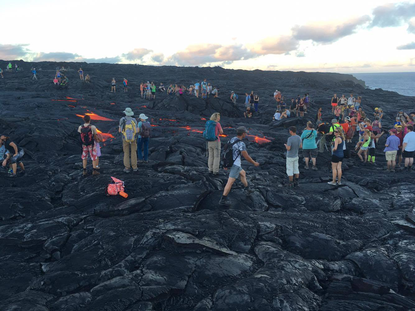 A crowd gathers around the distal tip of the 61g lava flow as it crosses the road en route to the ocean. Photo by John Tarson of Epic Lava.