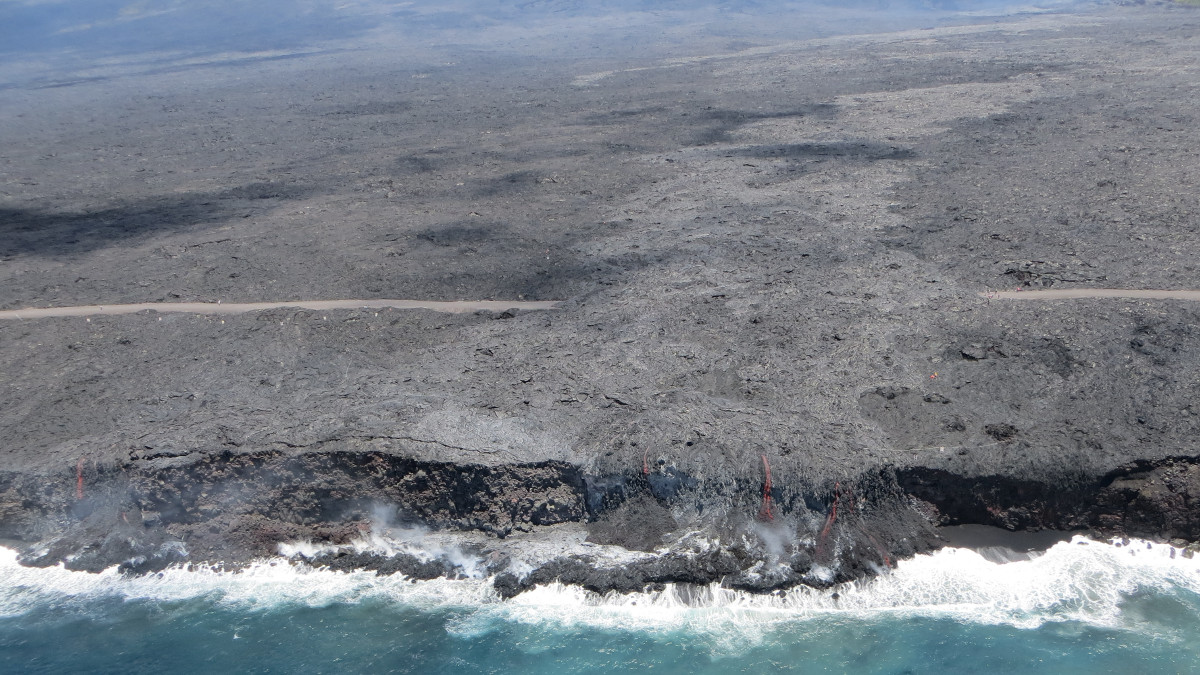 This USGS photo shows the two entry points observed Friday: the original one, where lava first entered the ocean on July 26 (near center of photo), and a smaller one to the west (far left side of photo).