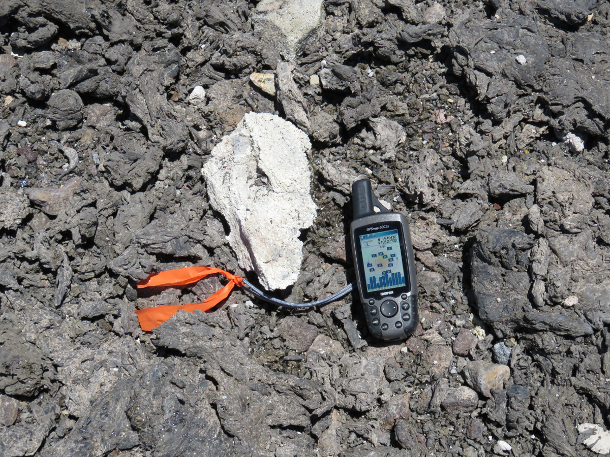 (USGS photo) The light-colored lithic in the center of this photo is about 20 cm (8 in) long—the GPS unit is shown for scale.