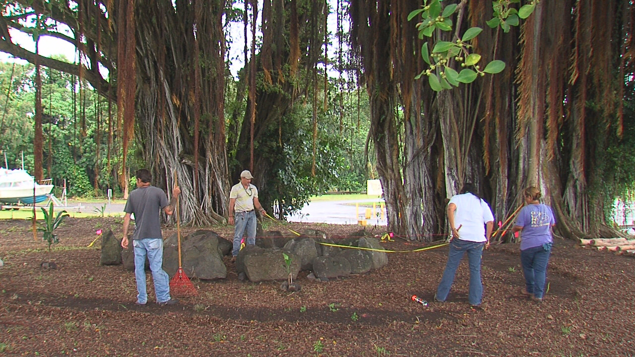 State workers prepare the area around the stones that once belonged to Kuakaananuu Heiau.
