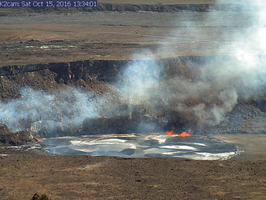 (USGS photo) In this image, captured by HVO's K2 webcam, you can see small spill-overs (shiny black lava) on the east (far left) and west (right) sides of the vent rim.