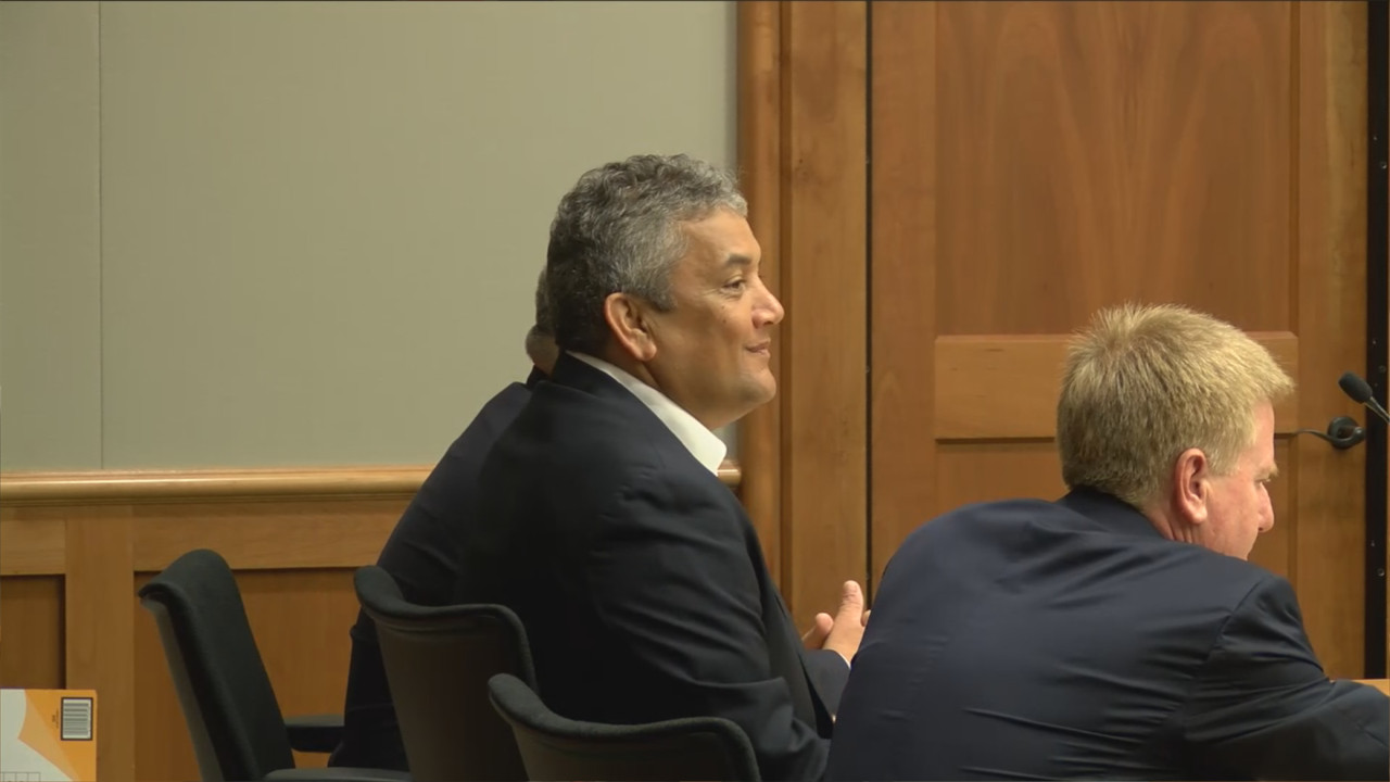 Mayor Billy Kenoi smiles in Hilo court before the opening statements are presented.