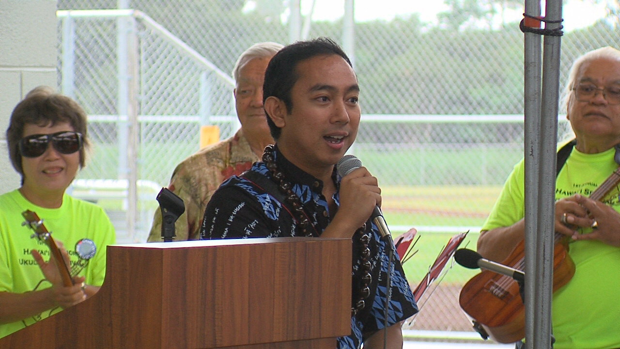 An enthusiastic Greggor Ilagan takes the mic during the Pahoa District Park grand opening.