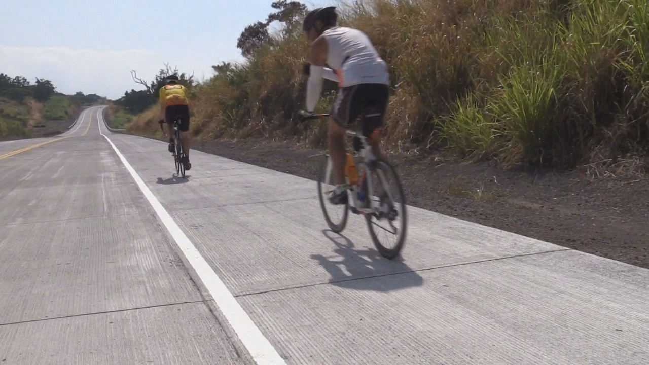 Cyclists ride over the newly opened road in South Kona.