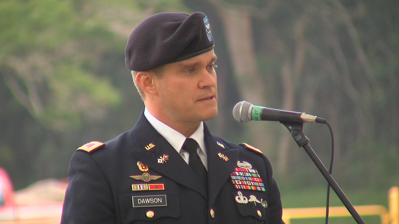 Colonel Stephen E. Dawson, U.S. Army Garrison-Hawaii commander, introduces Congresswoman Tulsi Gabbard on Friday.