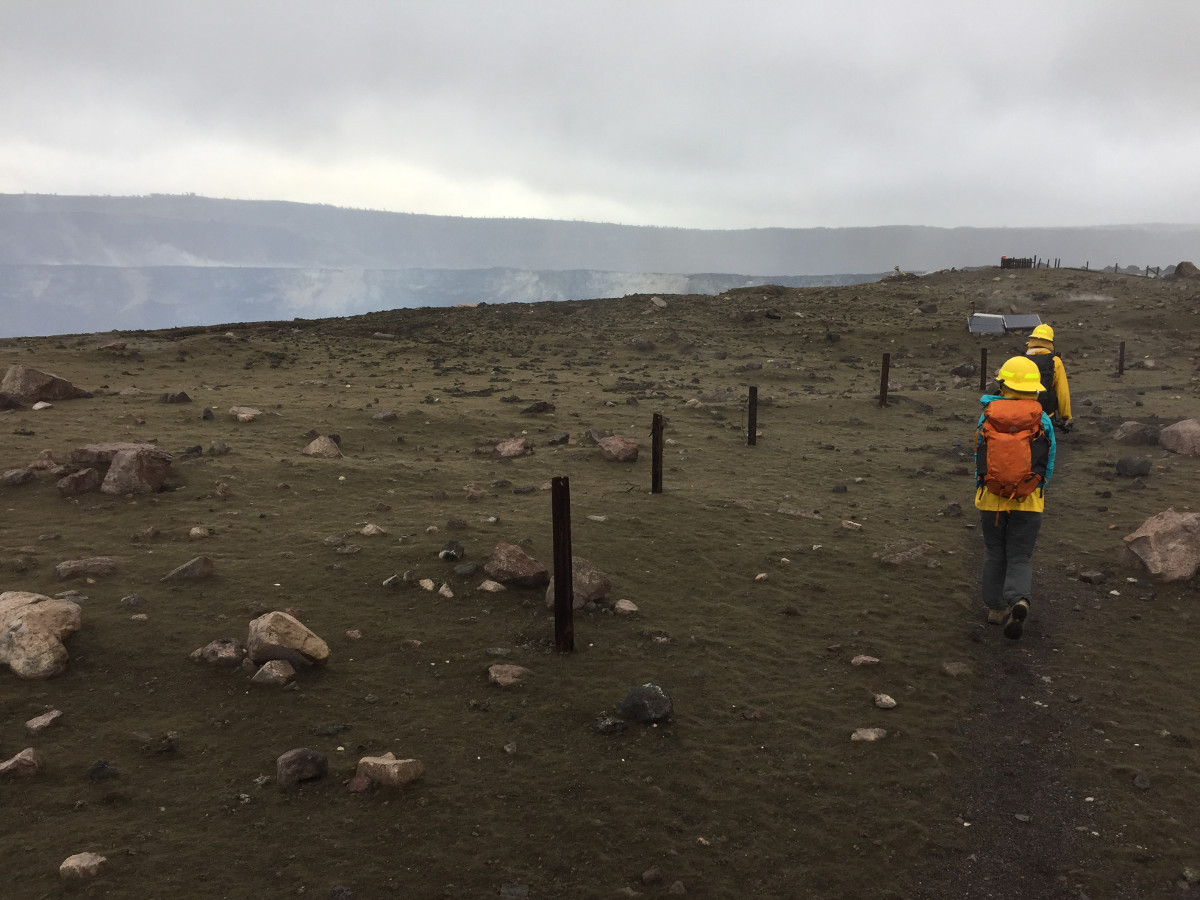 (USGS photo) HVO scientists visited the rim of Halemaʻumaʻu this afternoon (11/28) to collect samples of tephra and check for equipment damage. This view, taken on the approach to the Halemaʻumaʻu, shows the tephra deposit on the crater rim. New spatter is seen as dark lumps scattered across the center of the image on top of older brown-colored Pele's hair.