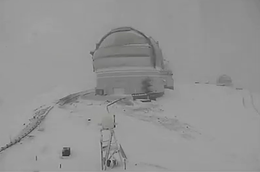 Image from the Canada France Hawaii Telescope webcam taken Friday on the snowy summit.