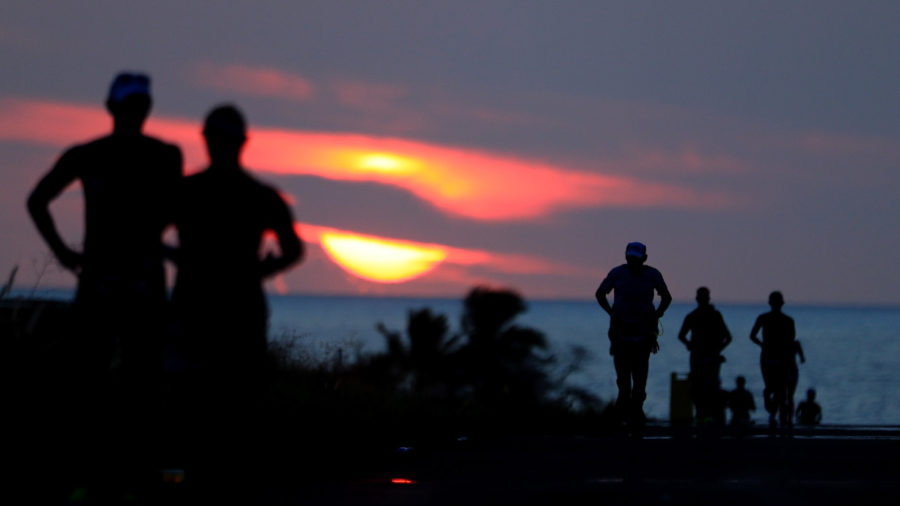 Ironman Athletes Fight Exhaustion To Finish Into The Night