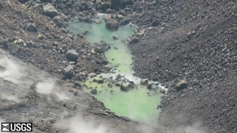 Water Ponds Join, Slowly Rise In Kilauea Summit Crater