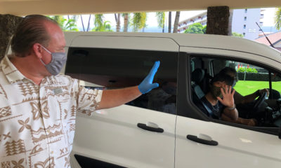Kona Beach Hotel Gives Employees Drive-Thru Care Packages